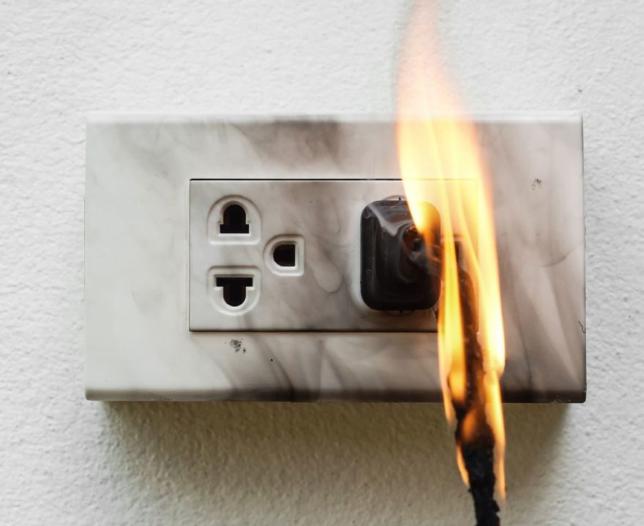 wire plug on fire
